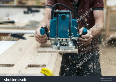 stock-photo-manual-wood-concept-cropped-close-up-photo-of-cabinetmaker-handcraft-tradesman-with-electric-tool-1316002970